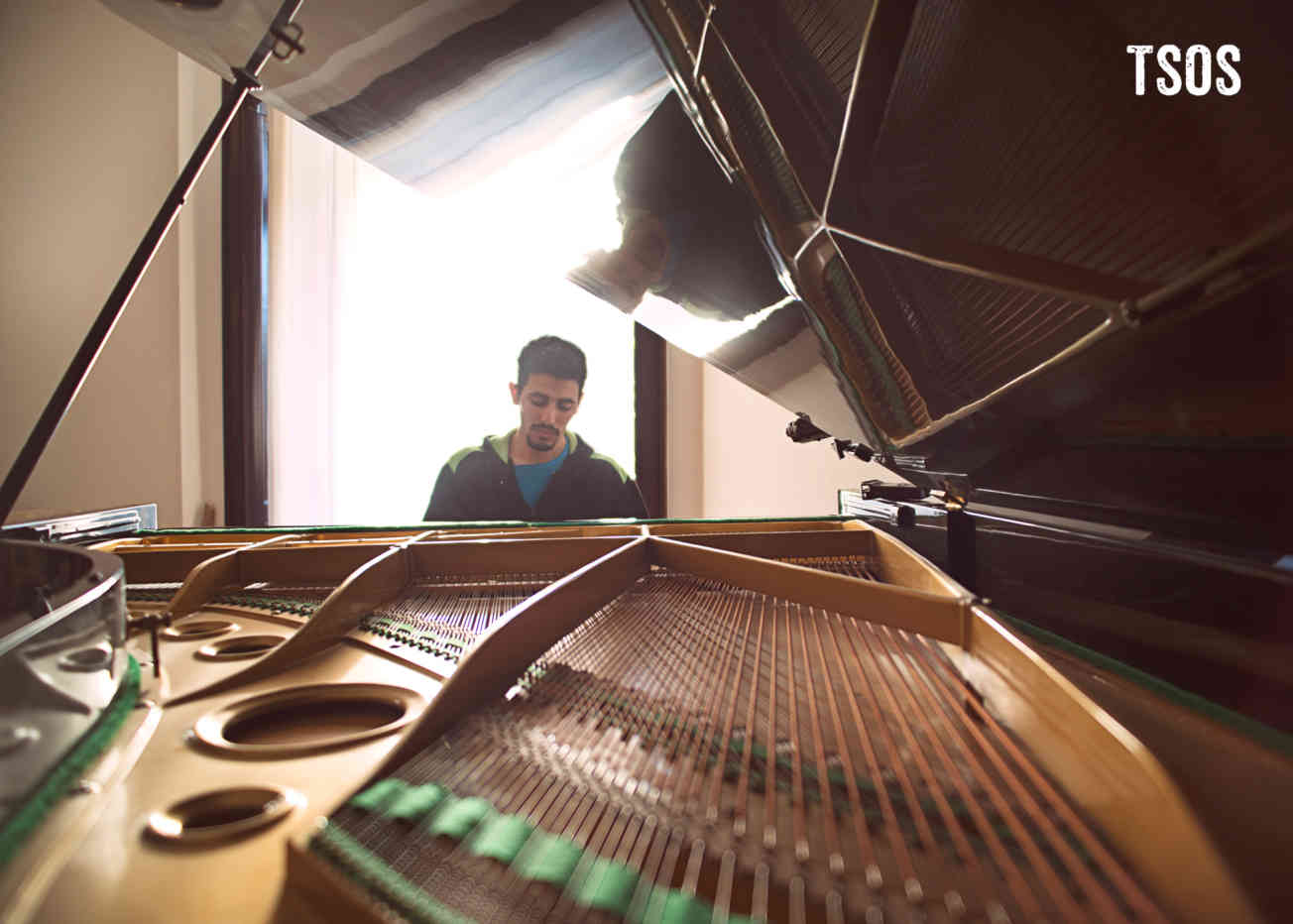 Aeham Playing Piano