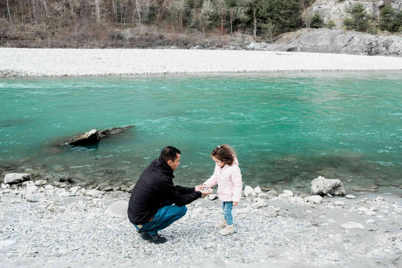 Hamed with his daughter at river
