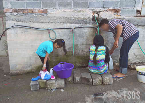 Habib Draws Water From Camp Hoses In Greece