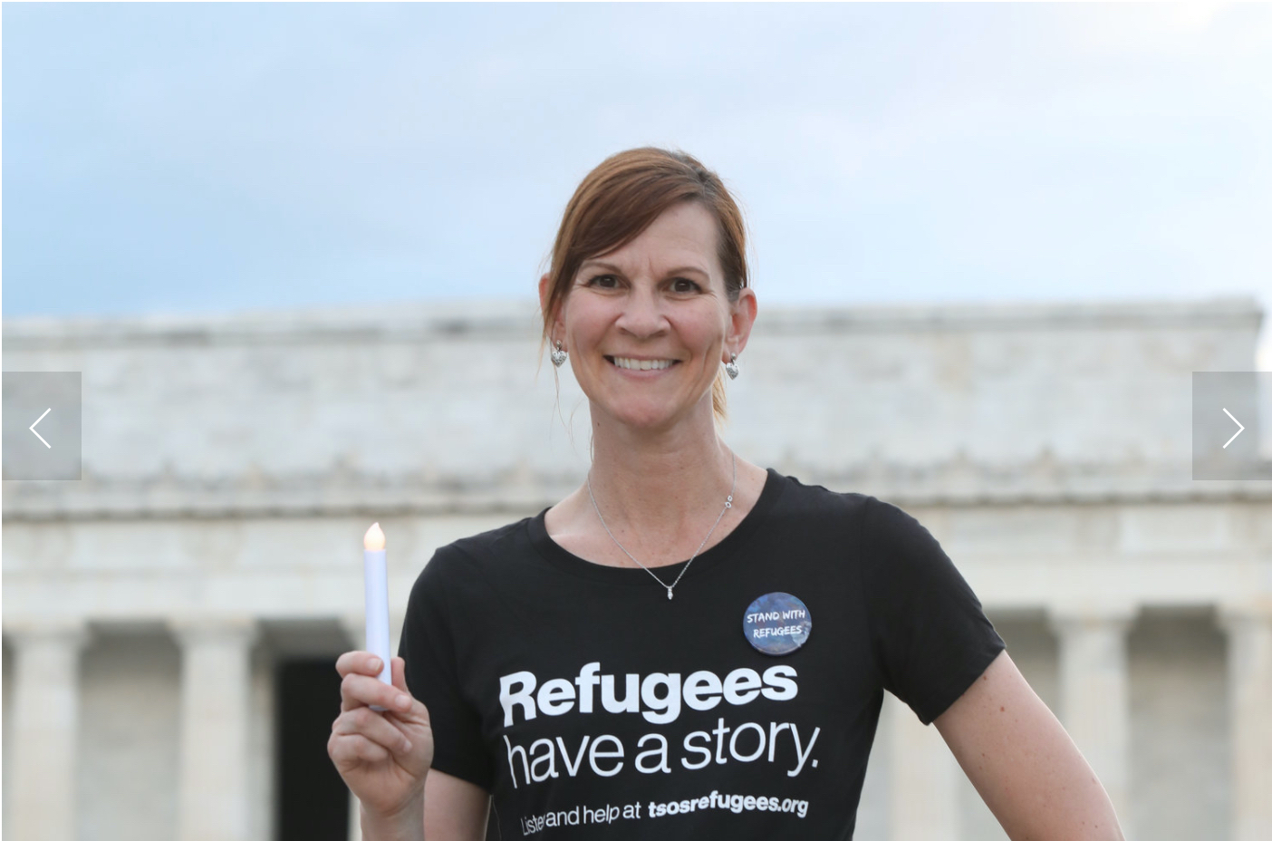 """Brandi Kilmer is dressed in a black """"Refugees have a story"""" Tshirt."""