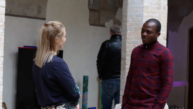 Phoebe Talking To African Refugee