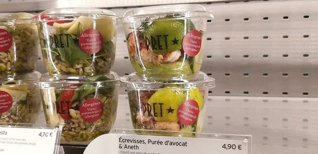 A row of stacked fruit cup containers await purchase or donation.