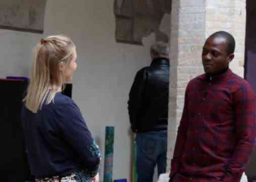 Phoebe Talking To African Refugee