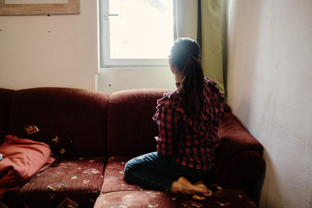 DEPORTATION WOMAN LOOKING OUT WINDOW