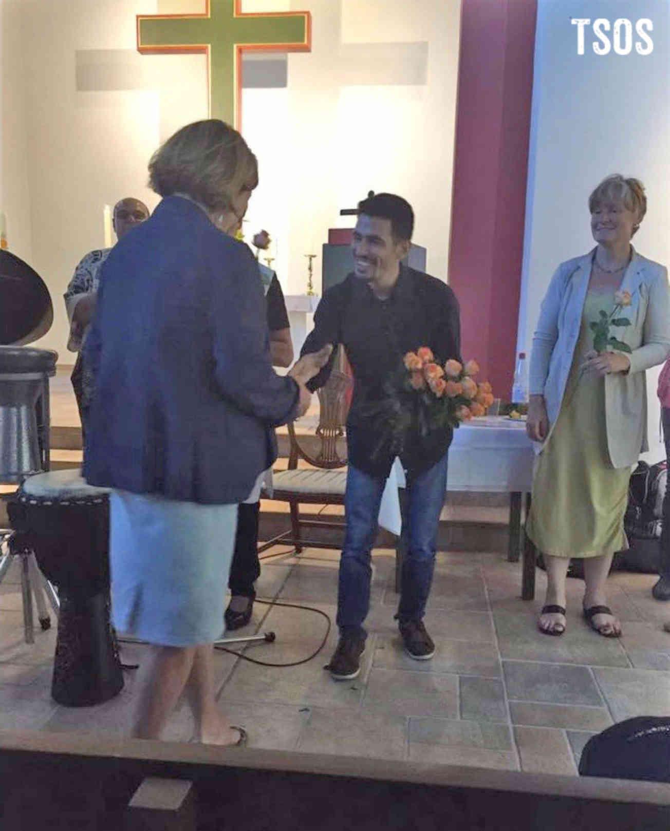 Aeham Giving Flowers