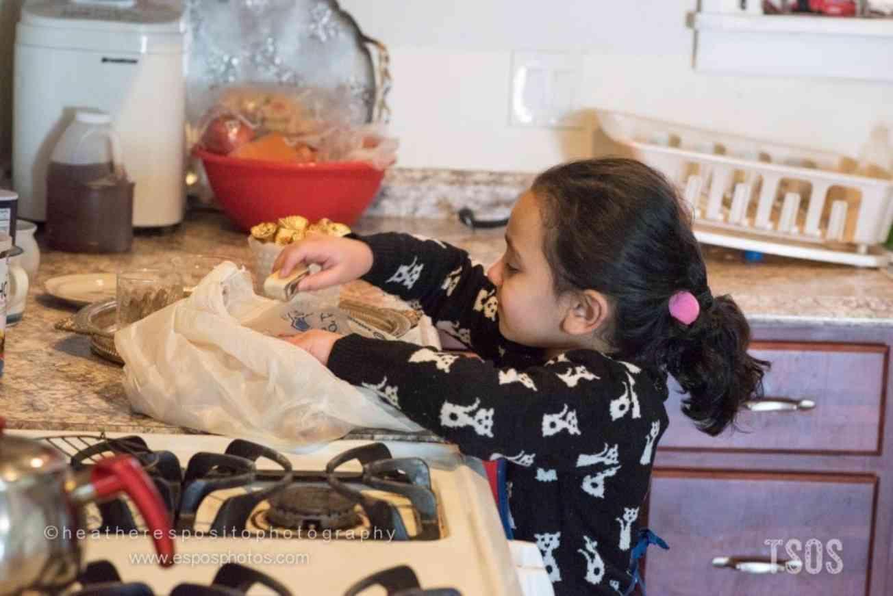 Sakina helping in the kitchen